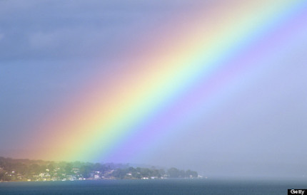 Rainbow over township of Nords Wharf, Lake Macquarie, New South Wales, Australia