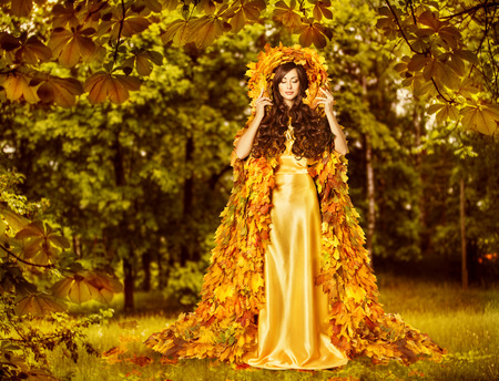 45240917-autumn-fairy-woman-in-forest-nymph-in-yellow-leaves-dress-fantasy-goddess-of-earth